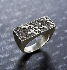 Workhouse studio member Denise Harrison of Sterling Echoes creates silver jewelry using a unique process.