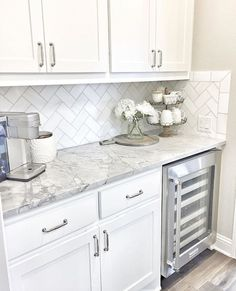 This classic white kitchen with fresh accents and open, glass louvered cabinets and subway tile backsplash is timeless.