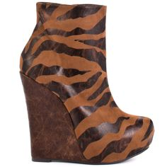 Luichiny makes it easy to let loose and have fun in this vibrant wedge.  Jam Ming brings you a animal print fabric covering the 1 inch platform and upper. Completing this ankle boot is an inside zipper and a brown faux leather overlaying the 5 inch wedge.