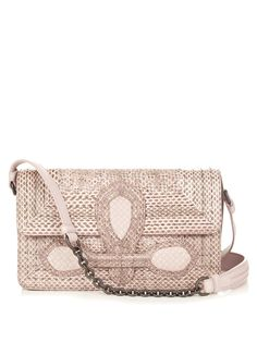 ca8d62cdeaa0 This pale-pink snakeskin shoulder bag is a modern re-work of an archival