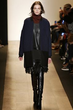 Love the gorgeous combination of rich colors and leather details. Fringe is all over the runway.