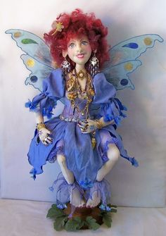 """LL511E  Bramble Goblin Tree PDF Cloth Doll Pattern  Designed by LAURA LUNSFORD this joyful 18"""" fairy is made to be seated. You'll find lots of fun embellishment techniques to adorn her."""