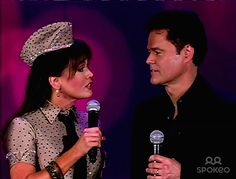 Marie Osmond and Donny Osmond The Osmond family performing the closing theme song of the 'Donny and Marie' variety show at Osmond's family reunion on ABC's 'Oprah'