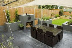 Dark Rattan Dining Furniture in Small Garden Design