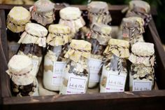old milk bottles filled with chocolate chip cookie ingredients... cute again for party favors