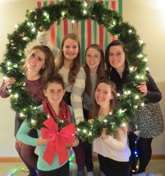 "Fun holiday ""Picture"" frame shaped as a wreath! Awesome photo booth opportunities!   Materials:  Exercise hula hoop Garland Lights Bow"