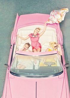 three girls in a barbie car