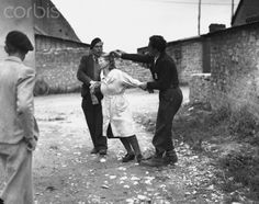 Punished for Collaborating with the Germans, 1944 - HU049105 - Rights Managed - Stock Photo - Corbis. Two French patriots try to cut off the hair of Juliette Audieuve as punishment for collaborating with the German forces occupying France during World War II, Liesville, France, 1944.