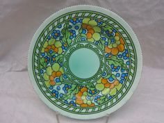 A Crown Ducal charger, designed by Charlotte Rhead in the 3052 Persino pattern, having a tube-lined decoration of stylised flowers and leaves on a pale green ground, printed and tubed marks verso to include a Rhead facsimile signature, diameter Green Ground, The Saleroom, 1930s, Charger, Tube, Charlotte, September, Auction, British