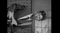 """King Krule – """"A Lizard State"""" music video  A black and white, topsy-turvy take on a simple performance piece that highlights the anachronistic feel of (a very dapper) Archie Marshall's music. The wunderkind needs little more than a sharp suit and a guitar to make a lasting impression (to be honest just the tunes would do) but this video makes sure we get how very in control Marshall is of his own destiny whatever way the world spins around him."""