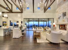 Love the large sliding doors in the LR. Living Room Gallery - Silverton Custom Homes Custom Home Builders, Custom Homes, Open Floor House Plans, Open Kitchen, Kitchen Dining, Dining Table, A Frame House, Floor Colors, Parade Of Homes