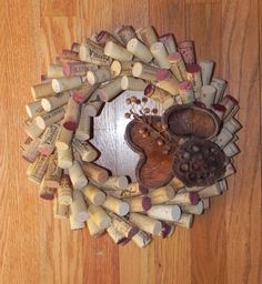 One of my cork wreaths decorated with natural plant items.  Find more of my work at nancybossert.artspan.com or nancybossert.blogspot.com or www.yessy.com/nancybossert