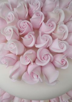 Beautiful pink sugar flowers on top of a Wedding cake, I love this more than a cake topper :)