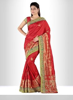 Get going with this majestic and wonderful piece and make your dream attire look richer to your persona. Add the sense of feminine beauty by this silk designer saree. This attire is nicely designed wi...
