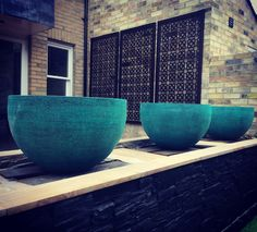 Fabulous water bowls by Uris Designs set against laser cut metal screens by Decori. Can't wait for this garden to be finished ....