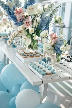 Nikki's Baby Shower | Real Celebration | Pastel Blue and Pink | Dessert Table | Balloon Arch | Party Ideas and Inspiration | HOORAY! Mag
