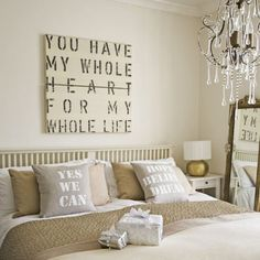 Love the wall art & the pillows!