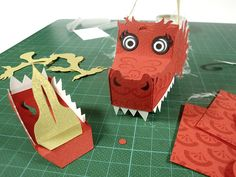 Happy lunar new year! 2012 is the year of the dragon and so I thought I'd make a little paper toy dragon freebie. I got carried away a little and so I now made 4 free printable paper dragon templat...