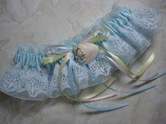 Beach wedding keepsake garter in satin, organza, and lace.