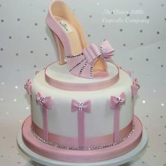 Cute Valentino pink shoe cake with bows