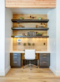 Small office space with built in desk, wood wall, white leather office chair and wood shelving   BLACKBOX design studios