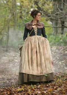 Claire attends the wounded during the boar hunt and is almost attacked by a boar herself.