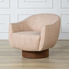 Sonara Swivel Chair - The sublimely comfortable barrel backed Sonara Chair features a tight upholstered seat atop a walnut cylindrical base with hidden swivel. Its organic, curvature and thin, sculptural back make for a soulful twist on a modern classic.