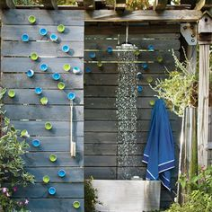 A chic outdoor shower is a must for a summer beach house or cabin.