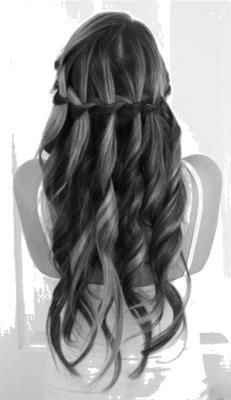 Intertwined waterfall braids with loose curls. Half up half down do. Romantic.
