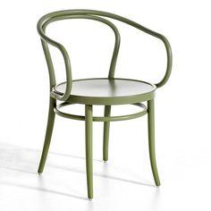 Un fauteuil vert comme table de chevet