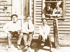 Fred Karno Troupe Co. Butte, MO, 1912-1913 [Charlie Chaplin sitting on the far right; Stan Laurel far right in the window]