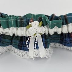 what bride's outfit is complete without a garter? This one is in tartan :)