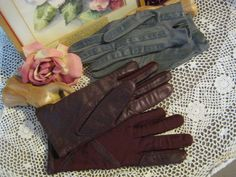 2 cool pairs of Isotoner stretch gloves grey pair maroon pair one size. $25.00, via Etsy.