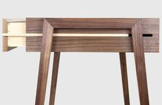 Animate Writing Desk - This striking desk combines thoughtful design and considered functionality, showing off the internal mechanics of the drawer system. Materials:Black American Walnut with a Maple leather lined drawer. Available in a blue or red leather. Dimensions: H 745 x W 1000 x D 520