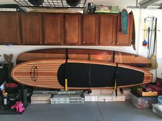 compact double paddleboard storage perfect for keeping your garage organized! #garagestorage #supstorage #storeyourboard