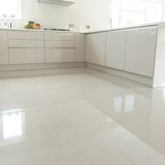 Super Polished Ivory Porcelain Floor Tile Is A Very Contemporary Ivory Tile,  Does Not Require Sealing.