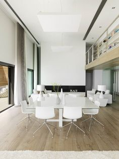 Amazing home with pure white modern interior architecture. Take a look and let us know what you think.