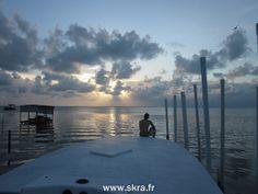 Bateau et coucher de soleil à Caye Caulker, Belize