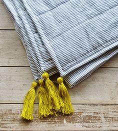 Beckman Seersucker Tassel Quilt by Hey Baby Craft Co. on Scoutmob