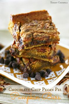 Pumpkin bars with gooey chocolate chip pecan pie filling baked right on top. My two favorite flavors in these Chocolate Chip Pecan Pie Pumpkin Bars.