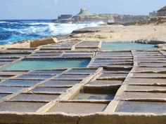 Saltpans are one of the most interesting features of the Maltese coastline. The pans are used to collect sea water which is gradually dried up by the sun, to leave a white residue. This is then collected, cleaned and refined to produce sea salt. Some of the best saltpans are the ones located at Qbajjar, near Marsalforn in #Gozo, #Malta │ #VisitMalta visitmalta.com