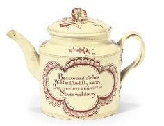 AN ENGLISH CREAMWARE CYLINDRICAL TEAPOT AND COVER CIRCA 1775 Decorated in shades of iron-red with a romantic verse to one side within a quatrefoil cartouche, the other side with scattered flower-sprays, within rouletted lines