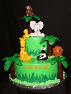 jungle theme kids birthday cakes | Animal figures and palm trees made entirely of modeling chocolate and ...