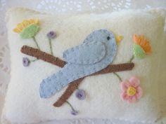 Hello! Welcome and thanks for stopping by.  This Bird pillow is made entirely from top quality wool felt in pastel colors. Would make a wonderful gift for any quilter!  Each piece is hand cut and hand embroidered with DMC floss.   Pillow is stuffed with poly fill and measures 5 1/2 inches by 4 1/2 inches.  For more info about this item please vist www.etsy.com/listing/79646097/wool-felt-appliqued-pillow-...  or www.pennysbykristie.etsy.com