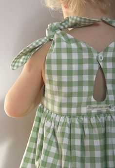 A classical girls dress shape from the 50s...We love our Rabbit Dress!Knotted on the shoulder with a teardrop detail in the back.Green/white checked cotton.Made in GermanyON SALE! WAS €79 NOW €49!!!