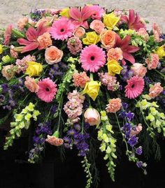 Fuller size casket spray created in yellow, purple, & pinks. Flower can be changed but it is shown w Church Flowers, Funeral Flowers, Wedding Flowers, Casket Flowers, Funeral Caskets, Funeral Sprays, Cemetery Decorations, Casket Sprays, Funeral Flower Arrangements