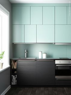Ikea: The monochrome kitchen. Light Turquoise gaps Flädie combined with trämönstrade black TINGSRYD.