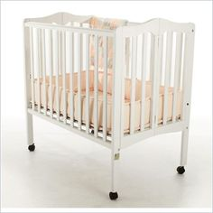 Dream On Me Dima 2-in-1 Lightweight Folding Portable Wood Crib in White- Could use 2 for changing room