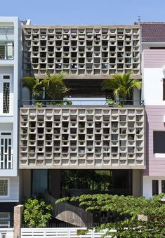Working alongside architects Sanuki + Nishizawa, Vo Trong Nghia Architects designed the six-storey Binh Thanh House for three generations of a single family, adding curved concrete ceilings, a spiral staircase and gardens on each floor.