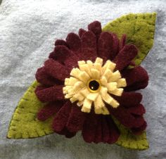 Loving to accessorize? This high fashionable flower pin can accessorize your hat, scarf or lapel the options are endless! by UpcycleDesignsByDana on Etsy